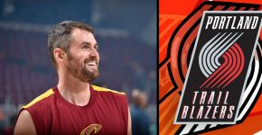 Kevin Love Smiling With Trail Blazers Background